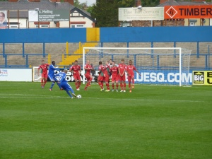 Barnes-Homer attempts a first half free-kick from range