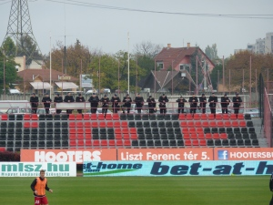 With no crowd trouble to keep them occupied the riot police watch the game unfold