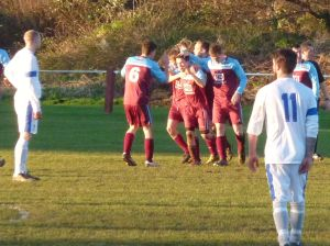 Lush opens the scoring for Malvern and gets congratulated by his team mates