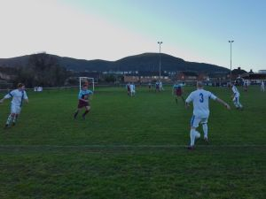 Lye's left back joins another attack as the sun starts to set behind the Malverns